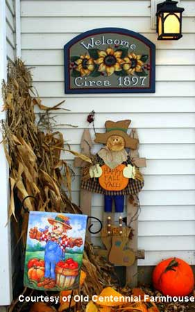 Decorating for fall with cornstalks, scarecrows and welcome signs