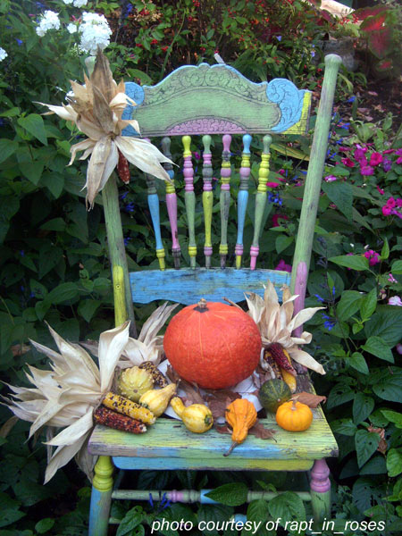 painted wooden chair decorated with gourds