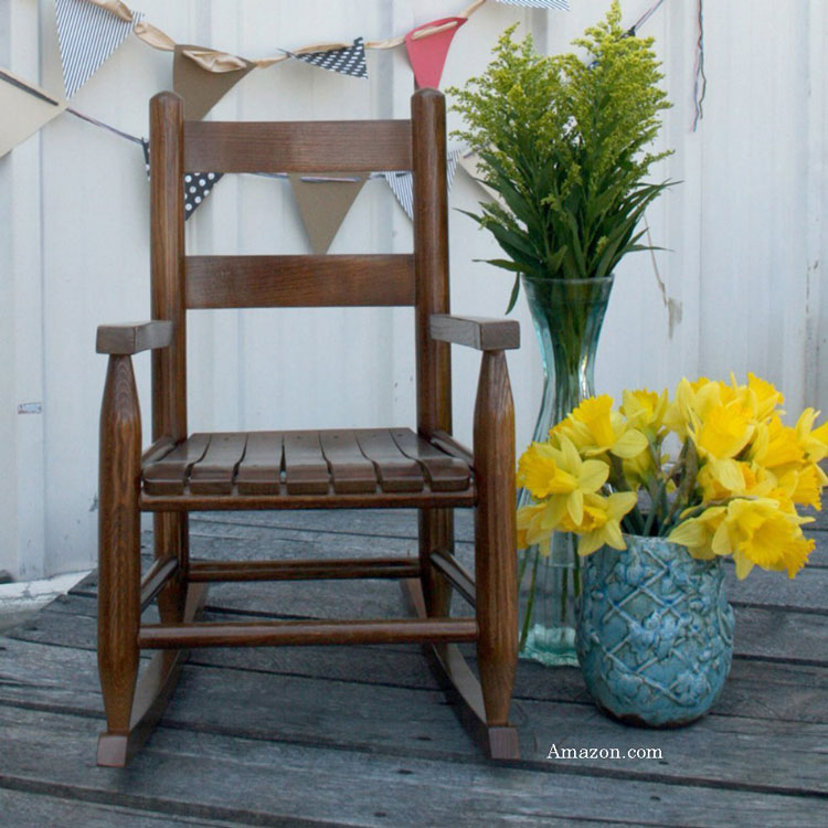 brown classic children's rocking chair on porch