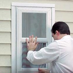 man replacing windows on mobile home