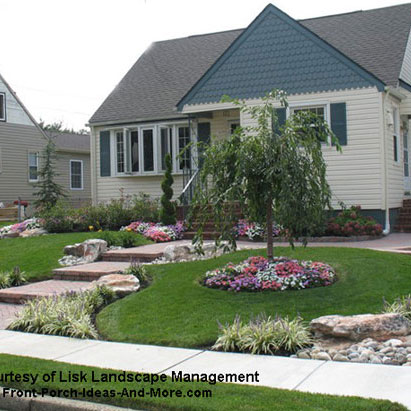 front yard professionally landscaped with walkway