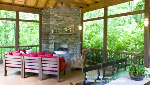 enclosed porch with rustic furniture and comfortable cushions