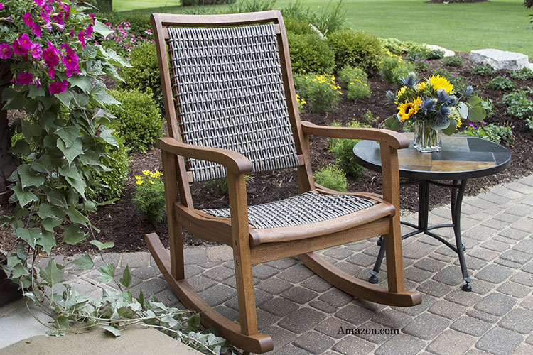 beautiful ecalyptus wood rocking chair with wicker seat on patio