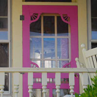 bright pink wooden screen door