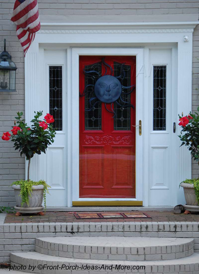 Beautiful red front door with black sun decoration