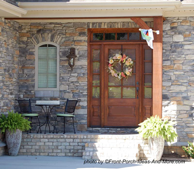 front door with side lights and decorative wreath