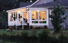 Screened porch windows on home
