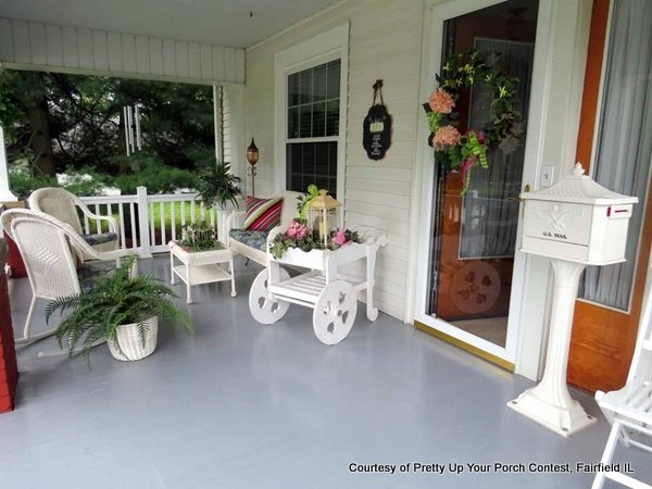 White wicker furniture on this pretty porch