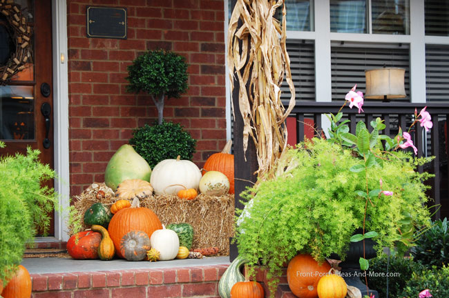 front porch decorated with traditional fall decor