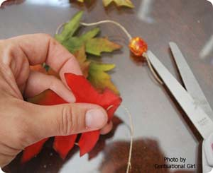 putting string through leaves