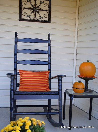 orange-striped pillows on porch furniture