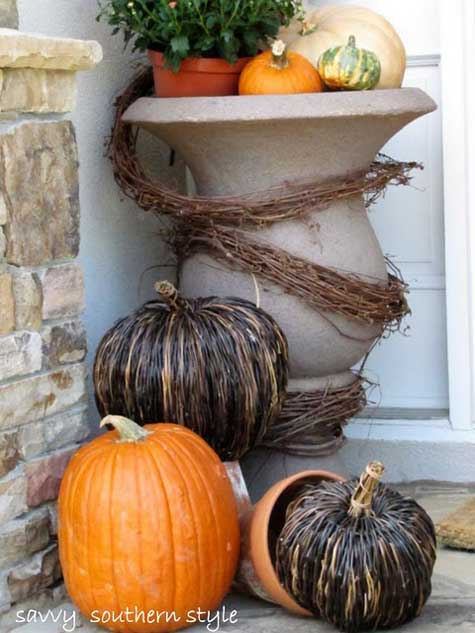urns filled with pumpkins