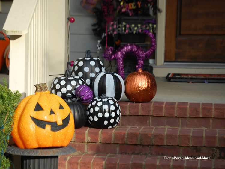 decorative fall and Halloween pumpkins on porch steps