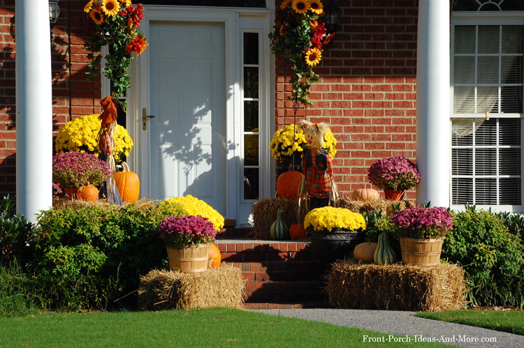 small front porch decorated for autumn in splended colors