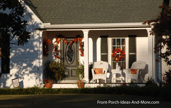 picturesque front porch decorated for fall