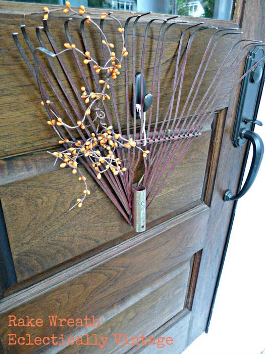 front door wreath made from a yard rake