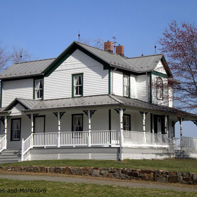 large traditional farm house home and porch