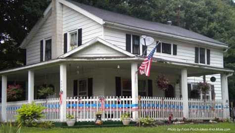 Wrap around country porch with gable roof at corner