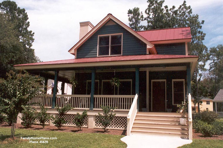 Large Farmhouse and porch built from Family Home Plans #65826