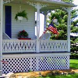 farmhouse porch decorated with a country theme