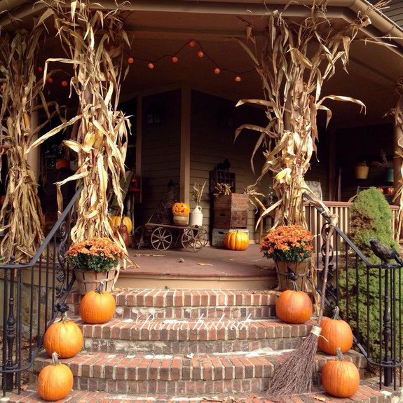 Thanksgiving decorated porch with faux pumpkin and leaves