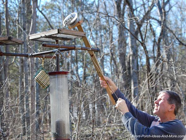 filling bird feeding station