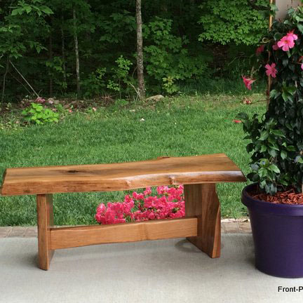 beautiful cherry garden bench on front porch