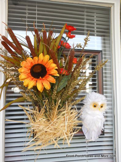 our cute autumn door decoration with a little snowy owl