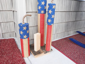 homemade firecracker decorations on wood platform