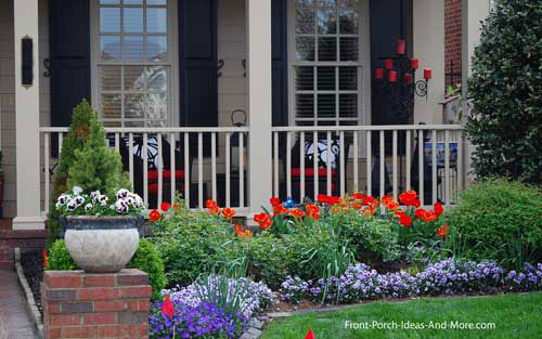 colorful landscaping in front of porch