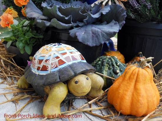 decorative turtle amongst autumn decorations