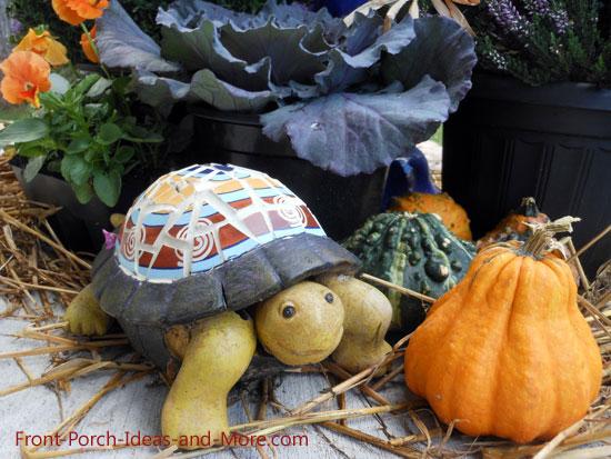 decorative turtle amongst autumn decorations