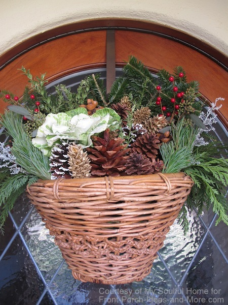 My Soulful Home; beautiful basket of fresh greenery on Kelly's front door shared at Front-Porch-Ideas-and-More.com #frontdoor #christmasporch #pinecones