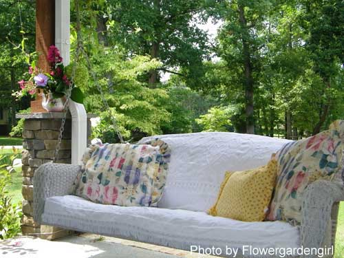 Anna's swing on her front porch - wicker, chenille, all so comfy