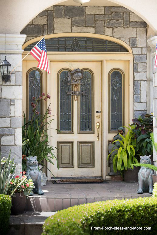 exquisite front door with sidelights on porch