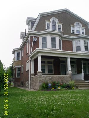 beautiful home in need of porch floor repair