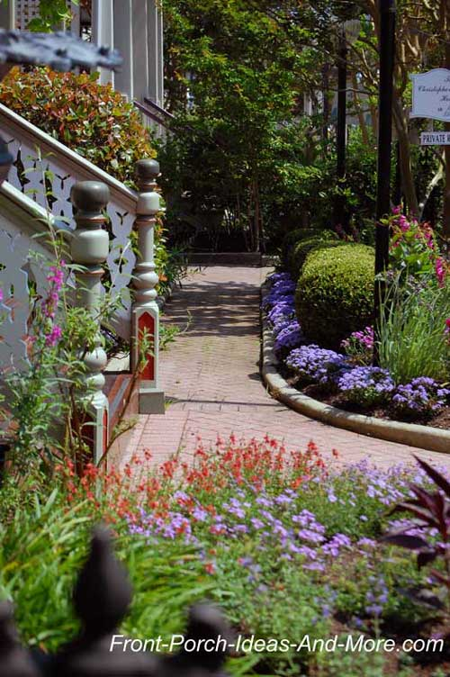 Colorful landscaping around porch and walkway - cottage style and lovely