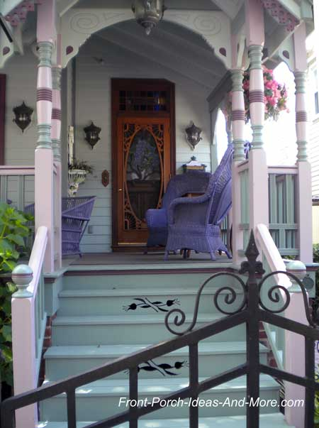 Victorian front porch painted in purple tones
