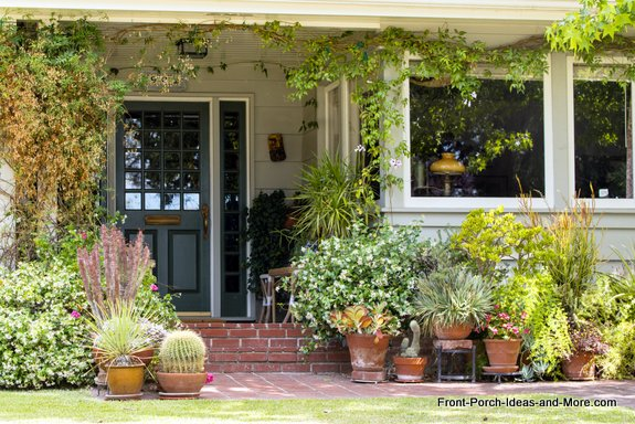 decorative planters enhance the look of this small porch