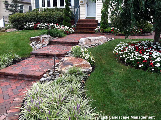 Beautifully landscaped yard by lisk landscaping management for Professional landscaping ideas