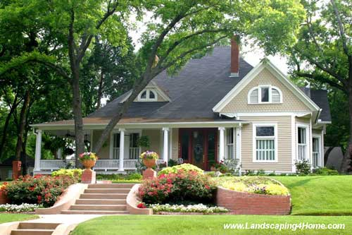 Beautifully landscaped front porch and yard  Beautiful landscaping. Porch Landscaping Ideas for Your Front Yard and More