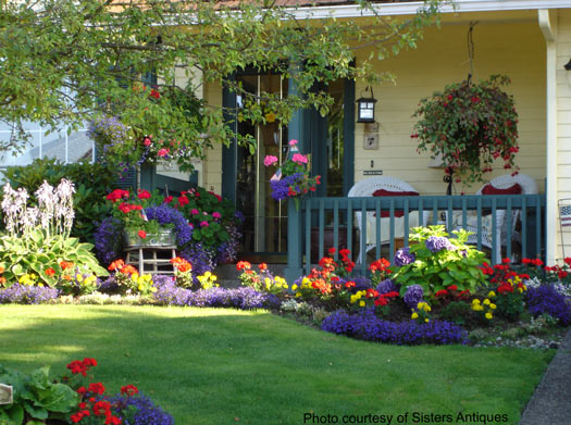 Front yard landscaping landscaping yards privacy for Front porch flower bed ideas