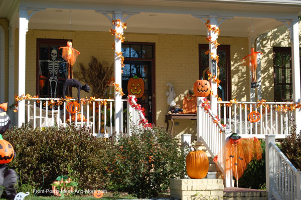 fun and very colorful halloween and fall front porch