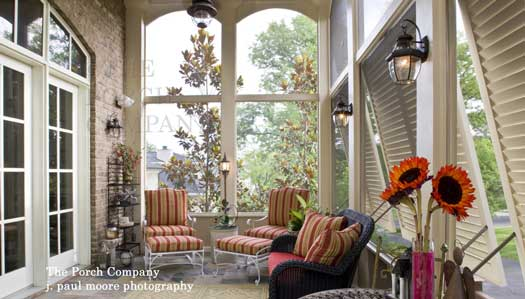 Custom screen porch with hurricane shutters and exquisite furniture