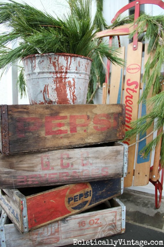 Vintage galvanized bucket atop soft drink carts - Eclectically Vintage