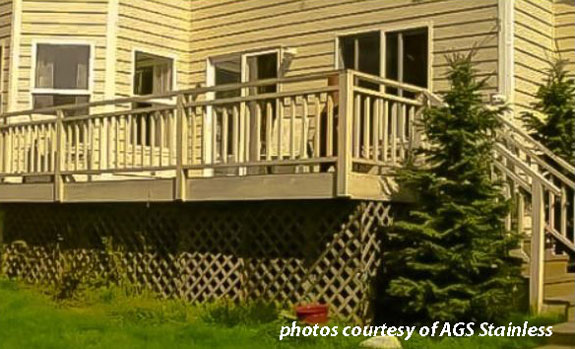traditional wood deck railings on back deck of home