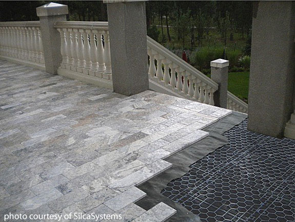 porch showing travertine stone being laid on silca® system grates