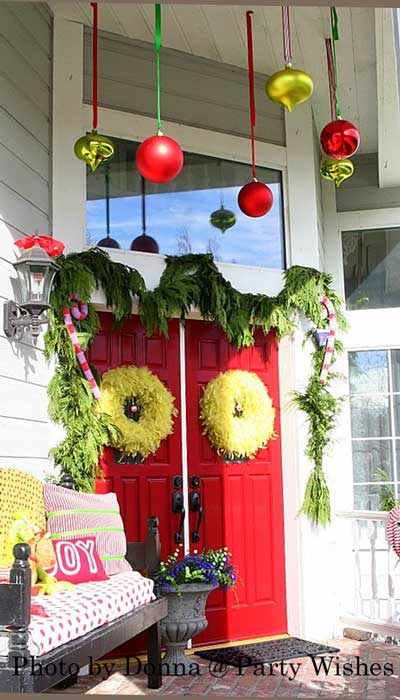 front door decorated in Grinch Christmas theme