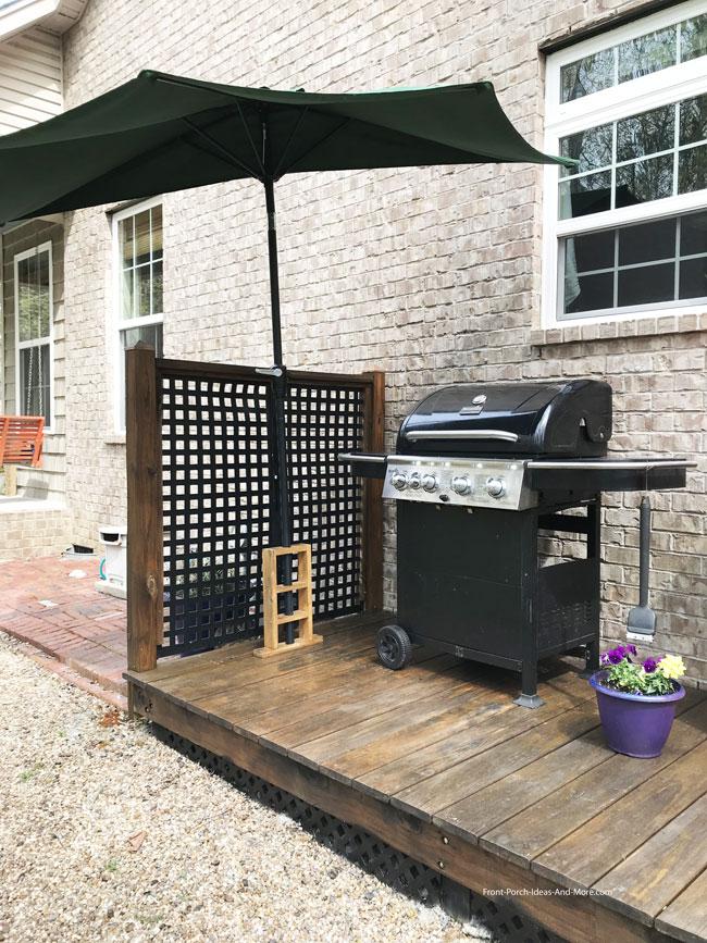 half umbrella over grill area