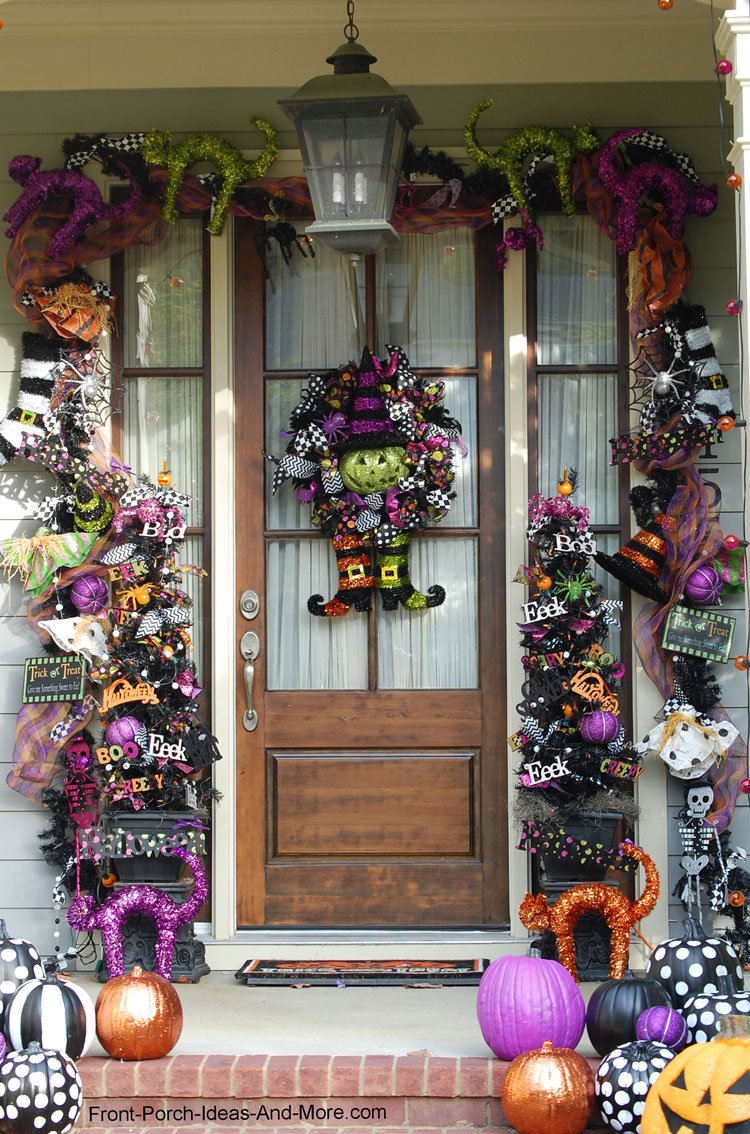 front porch door decoated with Halloween garland